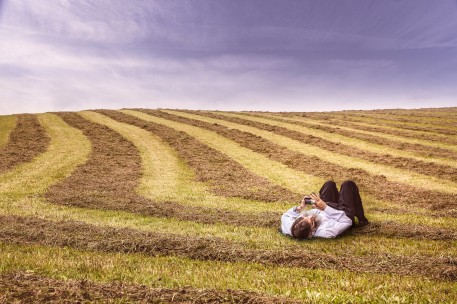 gratisography lying in threshed field