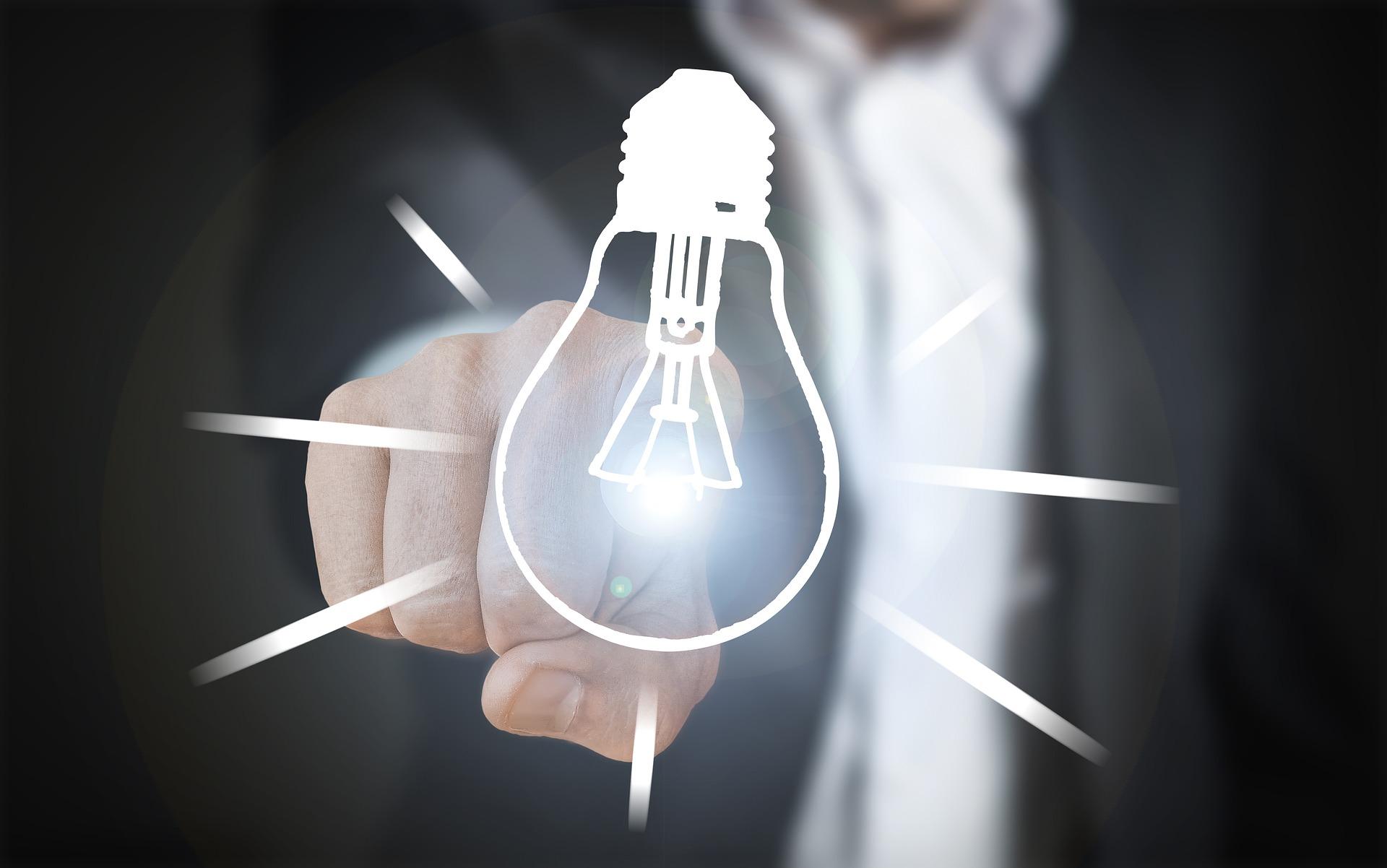 idea light bulb pointing finger