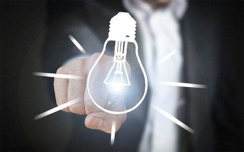 idea light bulb pointing finger