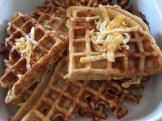 Waffles with grated cheese on top