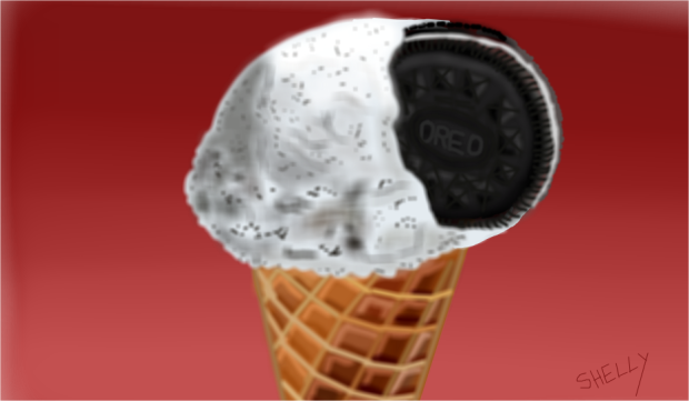 ice cream cone with Oreo cookie lodged in ice cream