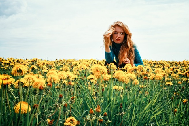 girl in field of dandelions