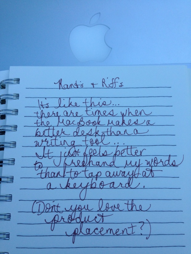 notebook page of writing sitting on top of a MacBook