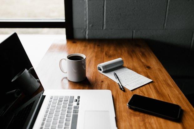 MacBook coffee mug and tablet