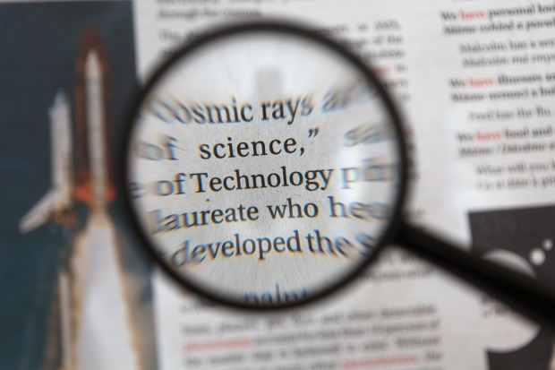 magnifying glass held over printed text